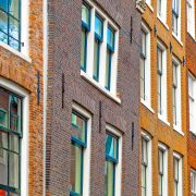 Masonry buildings tilting forward