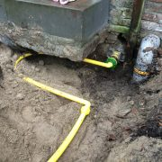 A home gas connection with an extra bend for settlement